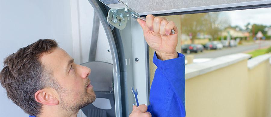 Technician Fixing Garage Door